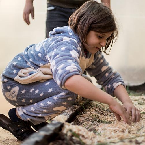 Leen planting Jerash camp